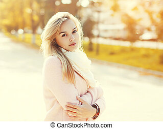 Portrait of beautiful young woman in sunny day