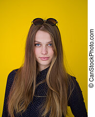 young woman isolated on yellow background