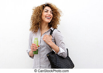 beautiful young woman laughing with bottle of juice