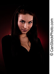 Portrait of beautiful young woman on the red background