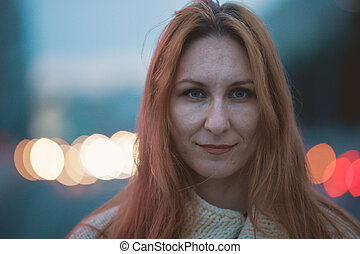 Portrait of beautiful young woman outdoor at evening