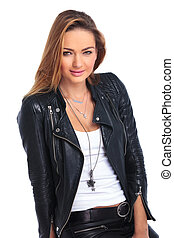 beautiful young woman posing in leather jacket