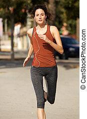 beautiful young woman running outdoors