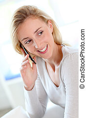 Portrait of beautiful young woman talking on mobile phone