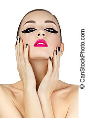 Portrait of beautiful young woman touching her face