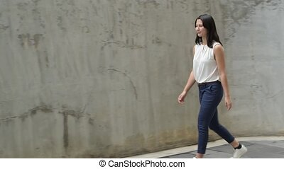 Portrait Of Beautiful Young Woman Walking Outdoors
