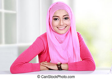 young woman wearing hijab - portrait of beautiful young...