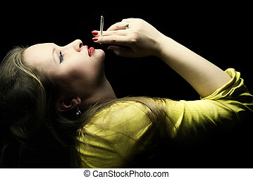 beautiful young woman with a cigarette in a hand