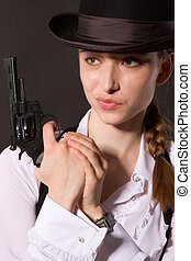 Portrait of beautiful young woman with a gun.