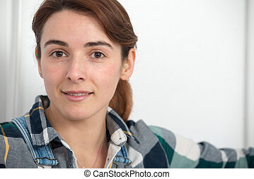 portrait of beautiful young woman with a plaid shirt