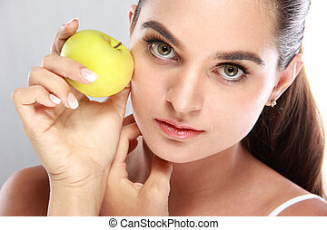 beautiful young woman with an apple in her hand