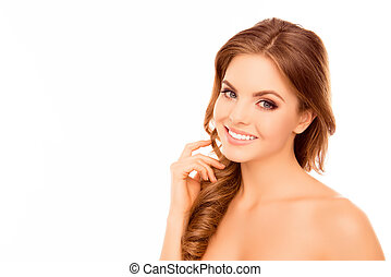 Portrait of beautiful young woman with beaming smile on white background