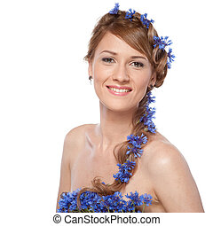 portrait of beautiful young woman with blue flowers