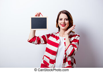 portrait of beautiful young woman with board on the wonderful white studio background