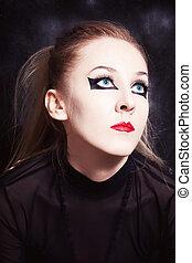 young woman with bright makeup closeup