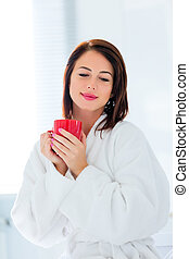 young woman with cup of coffee