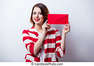 portrait of beautiful young woman with envelope on the wonderful white studio background