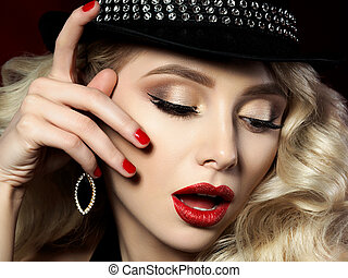 Portrait of beautiful young woman with fashion makeup