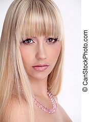 Portrait of beautiful young woman with long straight hair. Beauty