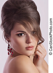 Portrait of beautiful young woman with makeup and with...