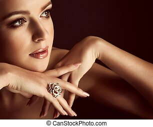 woman with makeup and with jewelry