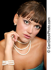 beautiful young woman with pearls