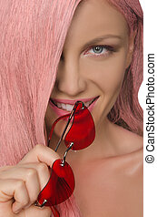 young woman with pink hair and glasses