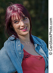 beautiful young woman with red hair, outdoors