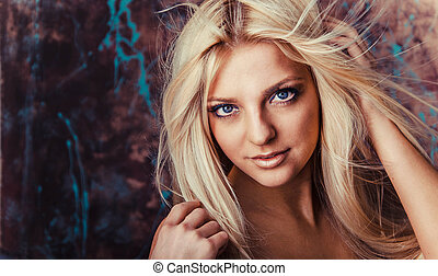 Portrait of beautiful young woman with long hair.