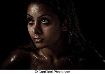 Portrait of beautiful young woman with wet face