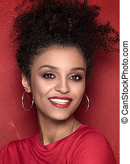 Portrait of beauty afro girl with toothy smile.