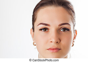 Portrait of beauty model with natural make up, formed eyebrows and long eyelashes