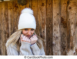 Portrait of beauty young woman in white cap with wood background