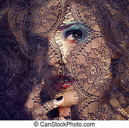 portrait of beauty young woman through lace