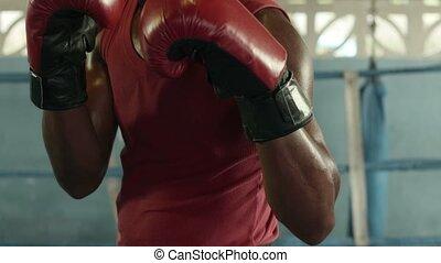 Portrait of black boxer in gym