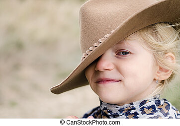 portrait of blond girl with hat
