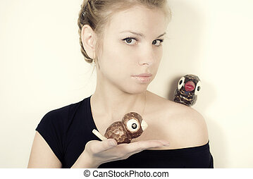 blond  girl with toys Birds