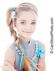 Portrait of blond little girl with blue eyes.
