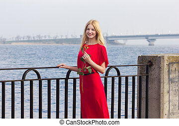 portrait of blond woman in red maxi