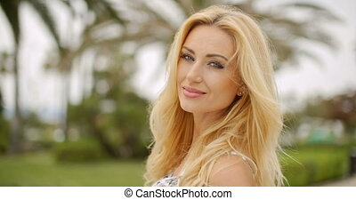 Portrait of Blond Woman Smiling at Camera