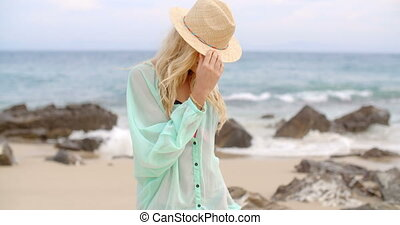 Portrait of Blond Woman Wearing Sun Hat on Beach