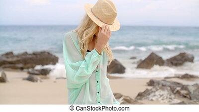 Portrait of Blond Woman Wearing Sun Hat on Beach