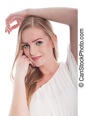 Blond Woman with Arm Over Head and Hand on Chin