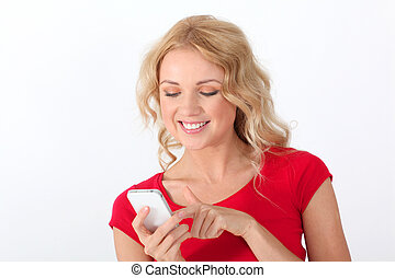 Portrait of blond woman with red shirt writing short message