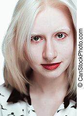 portrait of blonde albino girl in studio