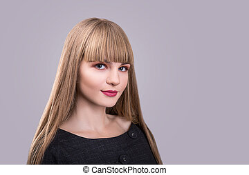blonde beautiful fashion girl with bang over gray background