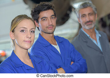 Portrait of blue collar workers stood in a row