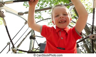 Portrait of boy at play-yard slomo - slow motion portrait of...