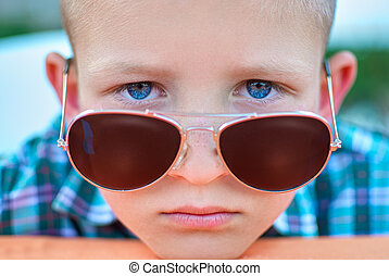 portrait of boy close up in sunglasses