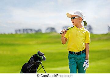 Portrait of boy golfer